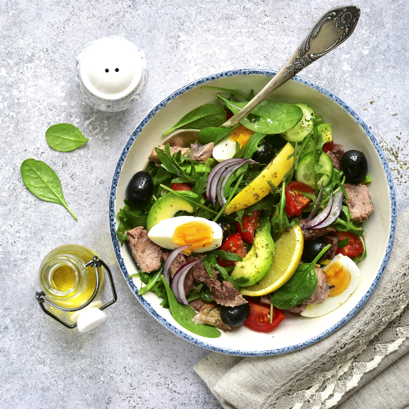 Tuna salad with mix salad leaves (spinach and arugula) , avocado, cherry tomato, cucumber and egg
